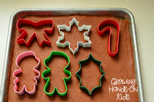 An easy recipe for homemade cinnamon applesauce ornaments, a perfect sensory experience for kids.