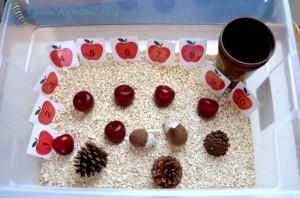Apple oatmeal sensory bin part of the apple theme tot school week. www.GoldenReflectionsBlog.com