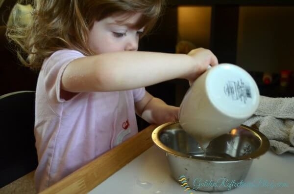 water pouring activity for dog themed montessori inspired tot school week. www.GoldenReflectionsBlog.com