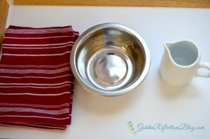 Pouring water tray for dog themed montessori inspired tot school week. www.GoldenReflectionsblog.com