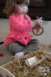 Playing with Nativity Sensory Bin.