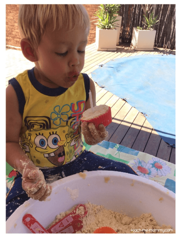 Birthday party pretend play with cloud dough for sensory play.