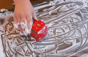 Shaving cream sensory play with cars