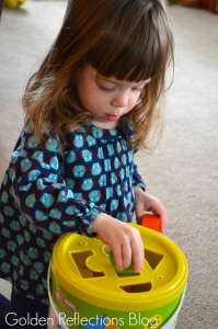 Matching and problem solving skills with wooden blocks for developmental play. www.GoldenReflectionsBlog.com