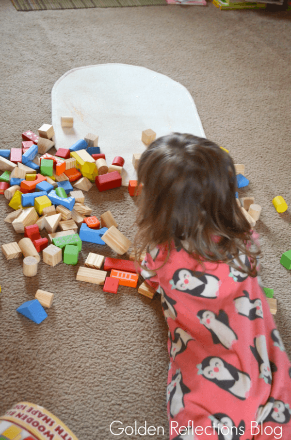Playing with wooden blocks for developmental play. www.GoldenReflectionsBlog.com