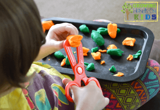 Introducing scissor skills to toddlers.