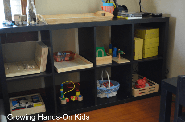 tot-school shelves in Montessori inspired space.