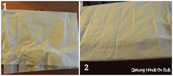 tissue paper kicking on the DIY discovery box for baby.