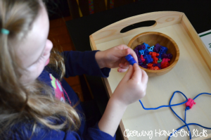 Letter T activities, stringing train beads.