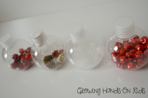 Christmas discovery bottles for baby, perfect for tummy time by the tree.