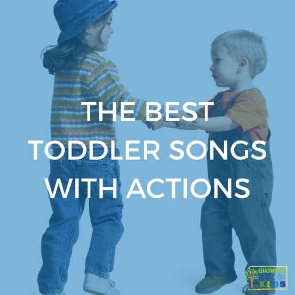 "Two children holding hands and dancing. Blue overlay with white text that says ""The Best Toddler Songs with Actions""."