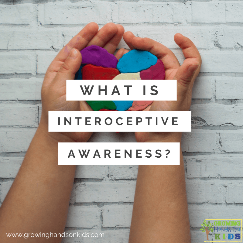 """white brick background with child's hands hold a multi-colored clay heart. White text overlay with gray words that say """"What is interoceptive awareness?"""""""